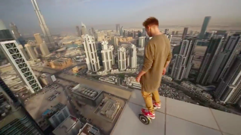 This Video of a Guy Hoverboarding Around the Top of a Skyscraper Is Nerve-Racking AF
