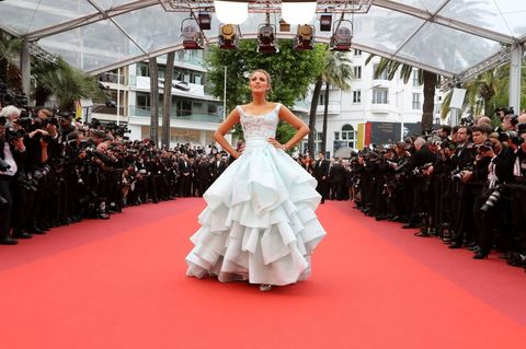 Event, Dress, Flooring, Outerwear, Formal wear, Style, Gown, Carpet, Fashion model, Fashion,