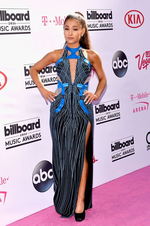 Dress, Flooring, Shoulder, Style, Premiere, Carpet, Logo, One-piece garment, Eyelash, Electric blue,