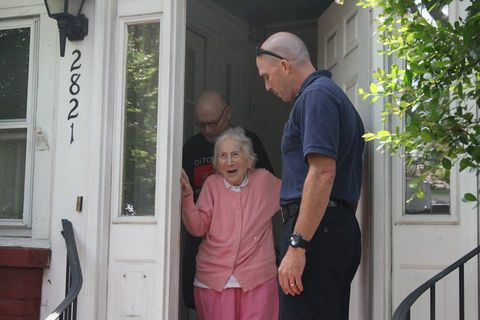 Human body, Standing, Door, Home door, Watch, Fixture, Cap, Wrist, Door handle, Polo shirt,