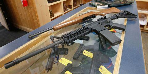 Gun, Firearm, Rifle, Machine gun, Trigger, Gun accessory, Air gun, Shotgun, Gun barrel, Hardwood,