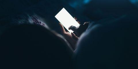 Imagini pentru using phone in bed