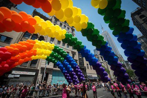 Architecture, Colorfulness, Party supply, Crowd, Orange, Magenta, Pedestrian, Arch, Balloon, Metropolis,