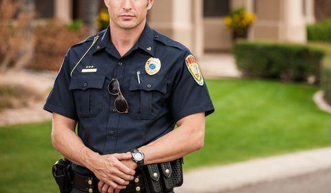 Collar, Sleeve, Dress shirt, Joint, Police, Uniform, Wrist, Police officer, Cap, Law enforcement,