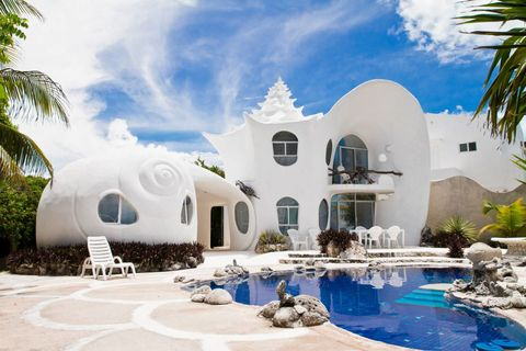 """<p>If the architecture alone wasn't enough to sell you on this unique rental, know that the property has it's own private pool and is located in the tropical island of Isla Mujeres, Mexico. This dreamy vacation home sleeps four and is a 15-minute golf-cart ride to the beach.</p><p>Rent it <a href=""""https://www.airbnb.com/rooms/530250"""" target=""""_blank"""">here</a>.</p>"""