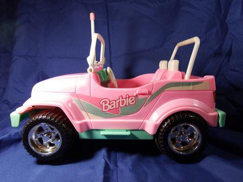 Automotive design, Transport, Toy, Pink, Fender, Automotive wheel system, Automotive tire, Magenta, Plastic, Toy vehicle,