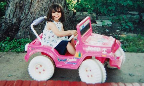 Tire, Human, Human body, Shoe, Pink, Happy, Sitting, Riding toy, Magenta, Fender,