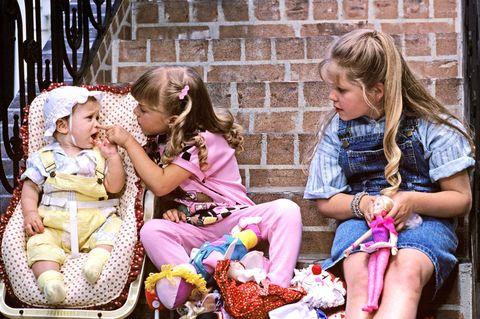 People, Sitting, Hand, Child, Brick, Baby & toddler clothing, Sharing, Lap, Toddler, Bag,
