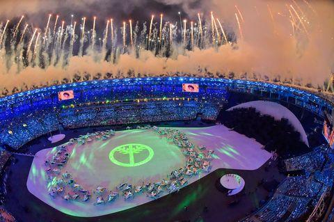 Sport venue, Landmark, Purple, Midnight, World, Stadium, Fireworks, Arena, Holiday, Circle,