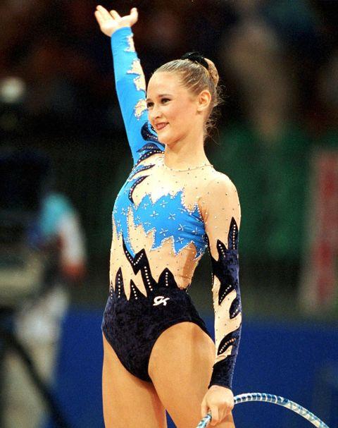 Sportswear, Gymnastics, Competition event, Elbow, Championship, Individual sports, Leotard, Trunk, Chest, Artistic gymnastics,