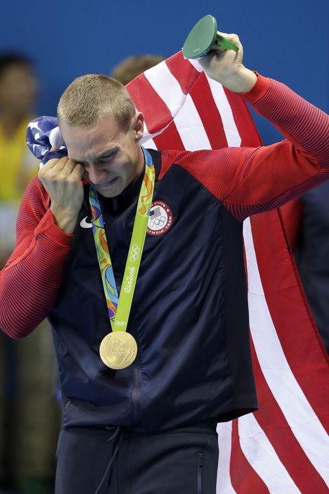 Medal, Award, Gold medal, Playing sports, Flag, Championship, Gesture, Celebrating, Individual sports, Belt,