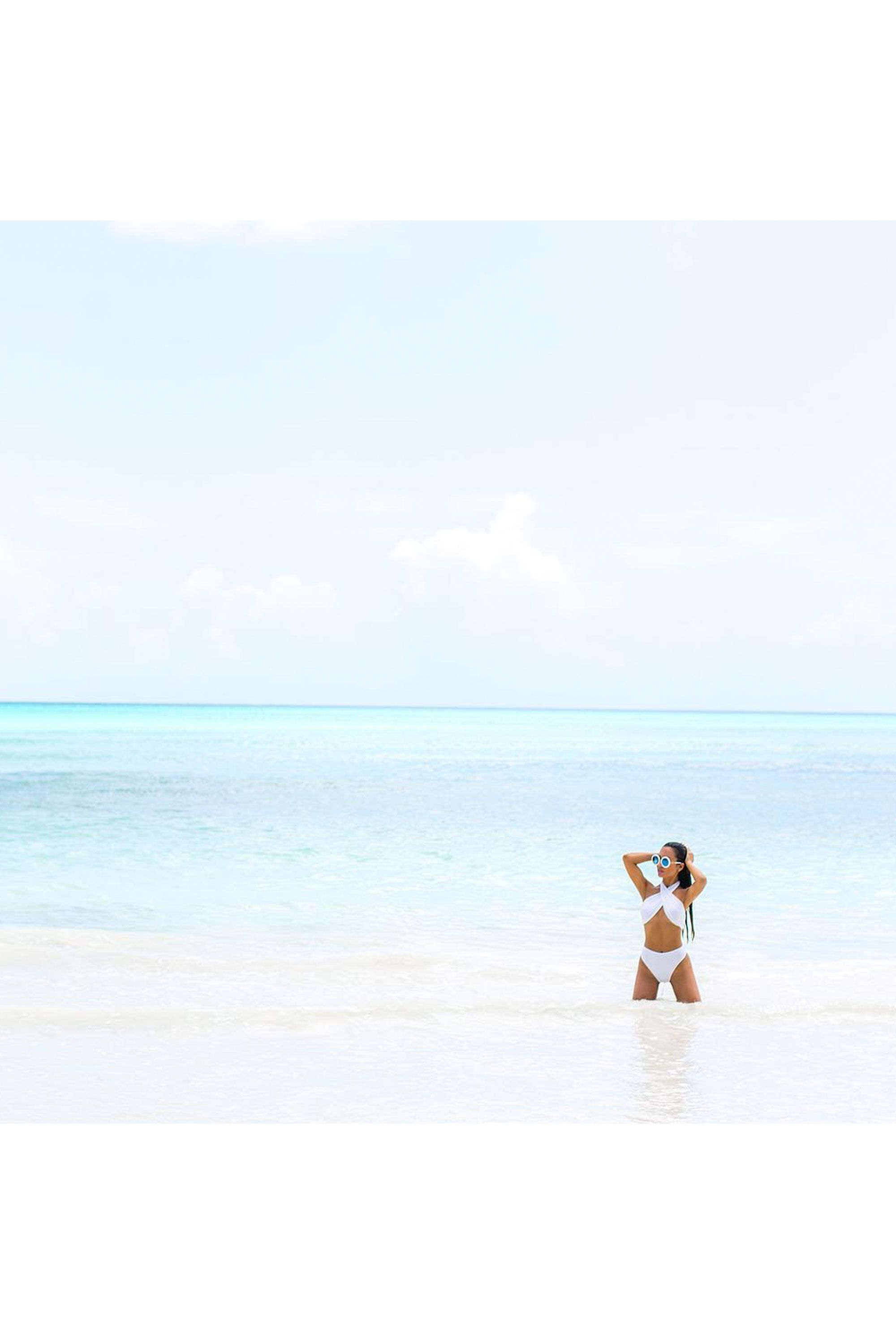 """<p>The perfect beach shot isn't <em>all</em> about a beautiful body posing in a two-piece — a breathtaking clear blue landscape can (and will!) steal your thunder. """"Play your position and work with the ocean,"""" suggests Malay. """"Situate yourself off to the side and capture the water in all its glory with the panoramic setting on your phone."""" This particular setting is key here — you'll get a higher shot than if you used the normal default setting.</p>"""