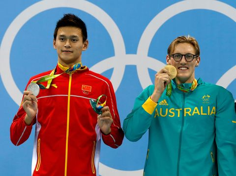Sleeve, Award, Sportswear, Uniform, Medal, Championship, Gold medal, Gesture, Glove,