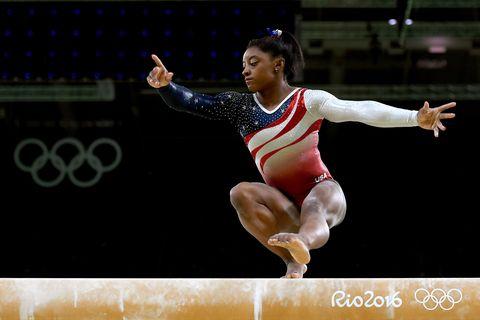 Sportswear, Human leg, Gymnastics, Jumping, Competition event, Artistic gymnastics, Championship, Knee, Athlete, Thigh,