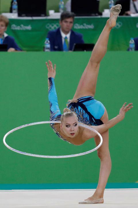 Arm, Human leg, Entertainment, Hand, Performing arts, Sportswear, Display device, Elbow, Rhythmic gymnastics, Sports,