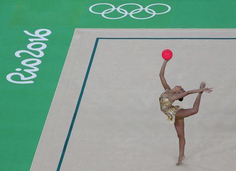 Human leg, Wrist, Knee, Ball, Gymnastics, Ice skate, Ball, Calf, Rhythmic gymnastics, Figure skating,