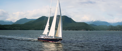 Watercraft, Mountainous landforms, Water, Mast, Boat, Mountain range, Highland, Coastal and oceanic landforms, Sail, Hill,