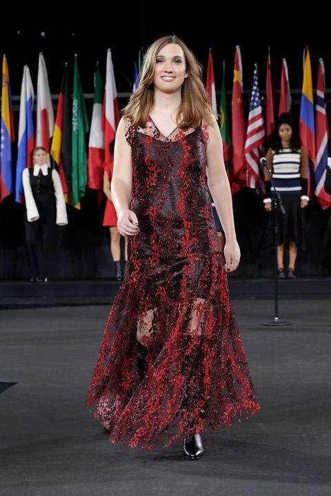 Flag, Dress, Textile, Shoe, One-piece garment, Fashion model, Fashion, Street fashion, Day dress, Fashion show,