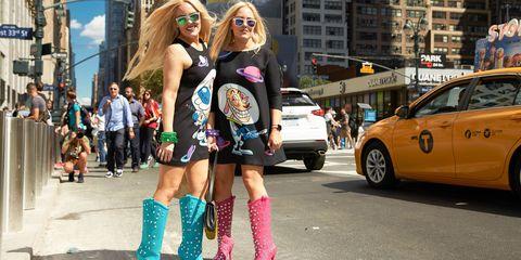 Street, Taxi, Shorts, Street fashion, Full-size car, Alloy wheel, Thigh, Pedestrian, Boot, Mid-size car,