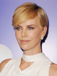 "<p class=""normal"">Charlize's cut remains polished-looking as it gets longer on the top. ""She has the back tailored beautifully into the nape and the top longer with some soft layering,"" says Cutler/Redken styling and grooming expert Jenny Balding. Style by applying a straightening cream such as <a href=""http://www.soap.com/p/redken-align-12-protective-straightening-lotion-56514"" target=""_blank"">Redken Align 12 Protective Straightening Lotion</a> ($18) and then blow dry, using an oval brush to pull hair toward the back on each side. Finish by using your fingers to sweep hair to one side to avoid a harsh part.</p>"