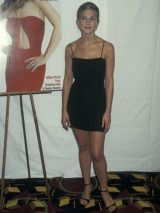 Celebrating her first Cosmo cover, Jen sizzles in an LBD.