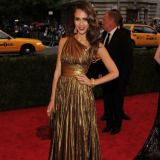 Wearing a metallic Michael Kors gown.