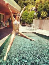We love this pic of Emmy Rossum because it just looks...fun. Sure, she looks hot, but that's secondary to the fact that she's obviously having a good time.  <br /><br /> <b>Copy It</b>: Have a friend snap a shot of you jumping into a pool or over some sand. Point your toes like Emmy (it makes your legs look leaner) and keep your arms straight. Try to keep your back straight as well to keep your abs flat. Oh, and have fun!