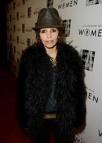 "<p>Linda Perry is pure rock and roll. This part-Brazilian has a long standing musical career, from being the front woman for <em>4 Non Blondes</em> to penning some of today's modern classics like fellow Latina Christina Aguilera's <em>Beautiful</em>. She used her badass musical skills to pop the question to her now fiancé Sara Gilbert by planning a musical picnic in the park. In addition to her musical achievements, she joined forces with the LA Gay and Lesbian Center to organize the event ""An Evening with Women"" in order to raise money for programs and services for women at the center. <br /><br /></p>"