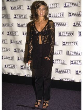 Gotta love the '90s. We bet the stylish star hasn't hung on to this outfit.
