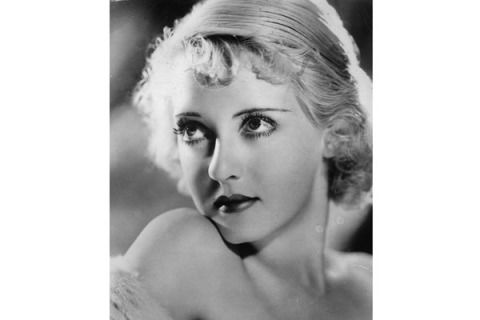 Bette's wispy fringe was incredibly chic with her polished, post-flapper bob.