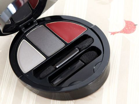 """<p>Limited edition for the holidays, this stunning palette has everything you need for a Major Night Out. Think silver-toned shadows, kiss-me crimson lipstick and a snowy white face highlighting powder. Festive!</p>  <p>Giorgio Armani Moonlight White All-in-One Palette, $88, <a href=""""http://www.saksfifthavenue.com/main/ProductDetail.jsp?FOLDER%3C%3Efolder_id=2534374306418163&PRODUCT%3C%3Eprd_id=845524446544299&R=3605521670359&P_name=Giorgio+Armani&N=4294912388+306418163&bmUID=jLrVatk"""" target=""""_blank"""">saksfifthavenue.com</a></p>"""