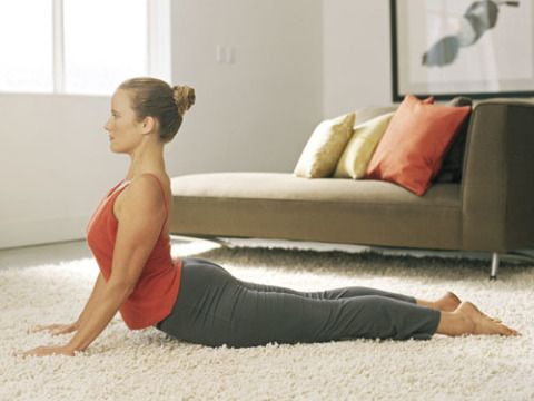 Lie on your stomach and put your hands right next to your body so your fingertips line up with your boobs. Press the tops of your feet and your hands into the floor and lift your upper body up (so you can see the TV.) Keep your elbows in by your body and hold it for 10 seconds. Repeat 10 times.
