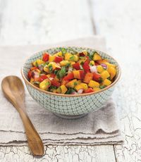 """<p>Replace the typical tomatoes with chunks of fruit for a fresh take on the classic spicy dip.</p><p><strong>Recipe:</strong> <a href=""""http://www.countryliving.com/recipefinder/peach-nectarine-salsa-recipe-clv0613"""" target=""""_blank"""">Peach-Nectarine Salsa</a></p>"""