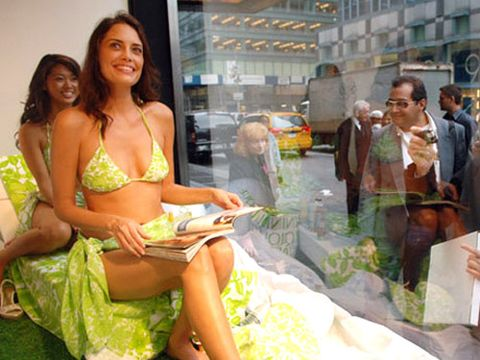 Female models are attracting attention to not only themselves, but their beautiful tan skin!