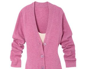 Wear a flimsy frock under a thigh-length cardigan, and let the dainty neckline and hem peek out flirtatiously.
