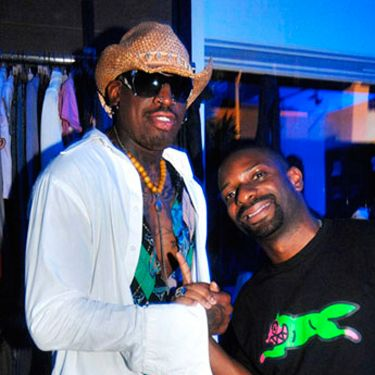 Dennis Rodman and DJ Irie pose for a pic during a party at the AG store in Miami.