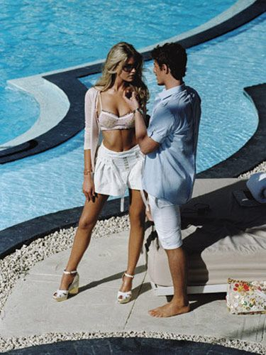 On her: Cardigan, bra, shorts, bracelet, and bag, Louis Vuitton; shoes, Hogan, $445; sunglasses, Tom Ford, $320; necklace, Becky Kelso, $460. On him: Shirts, Dolce & Gabbana, $550; shorts, Polo by Ralph Lauren, $59.50; watch, Louis Vuitton.