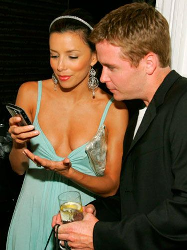 Eva Longoria shows Kevin Connolly  her new BlackBerry.