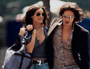 On her: Printed blouse, wide-leg jeans, $495, matte calf belt, $255, and paisley silk bag with croc trim, Michael Kors; sunglasses, Ray-Ban, $89, rayban.com; horn necklace, Chloe, $565. On him: Corduroy blazer, Dolce & Gabbana, dolcegabbana.it; button-down shirt, Prada, $410, 888-977-1900; jeans, Diesel, $159, diesel.com; sunglasses, Emporio Armani, $140, 866-246-9043