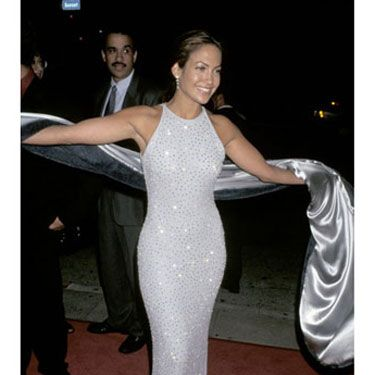 We knew there was a hot body under there—and she showed it off in this white sequin gown.