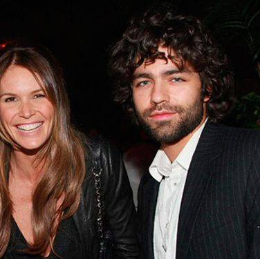 "Elle MacPherson and Adrian Grenier pose for a pic at the after party for the ""I'm Not There"" New York premiere."