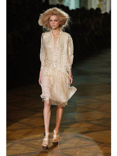 Clothing, Hairstyle, Shoulder, Fashion show, Human leg, Dress, Style, Fashion model, High heels, Runway,