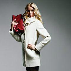 Coat, Searle, $598&#x3B; tights, Wolford, $40&#x3B; shoes, Christian Louboutin, $675&#x3B; bag, Carrie Valentine, $285&#x3B; bracelet, Seiden Gang