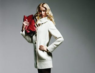 Coat, Searle, $598; tights, Wolford, $40; shoes, Christian Louboutin, $675; bag, Carrie Valentine, $285; bracelet, Seiden Gang