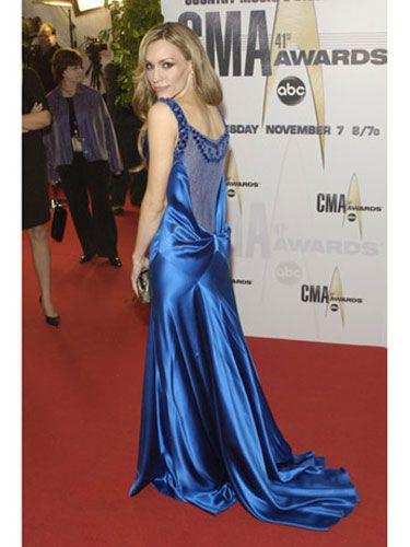 Clothing, Human, Dress, Shoulder, Flooring, Style, Formal wear, Premiere, Carpet, Gown,