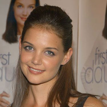 Katie's half-up 'do recalls her girl-next-door character, Joey Potter, on <i>Dawson's Creek</i>.