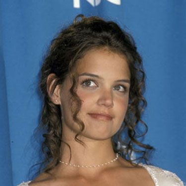A young Katie Holmes sports some girlie curls at the 47th Annual Emmy Awards.