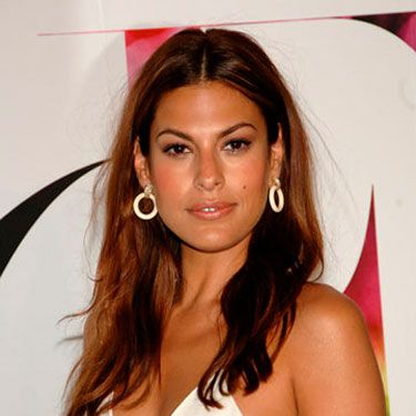Eva Mendes makes totally untamed summer hair look super glam, and so can you: Mist a thickening spray all over damp hair, then blow-dry while tousling it with your fingers. Once it's dry, wrap random pieces around a curling iron, stopping two inches below your roots. To finish, run fingers through your hair for a sexy, imperfect look.
