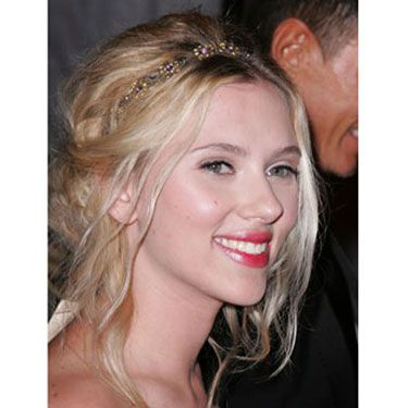 Scarlett makes this sexy updo low-key with wavy, face-framing tresses. To get the look, allow hair to air-dry, so you can work with your natural texture. If you need extra body, add wave-enhancing mousse to damp locks. 
