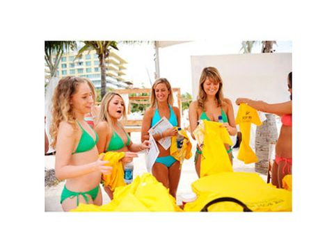 Cosmo girls collect goodies from one of the tents at the Bikini Bash.